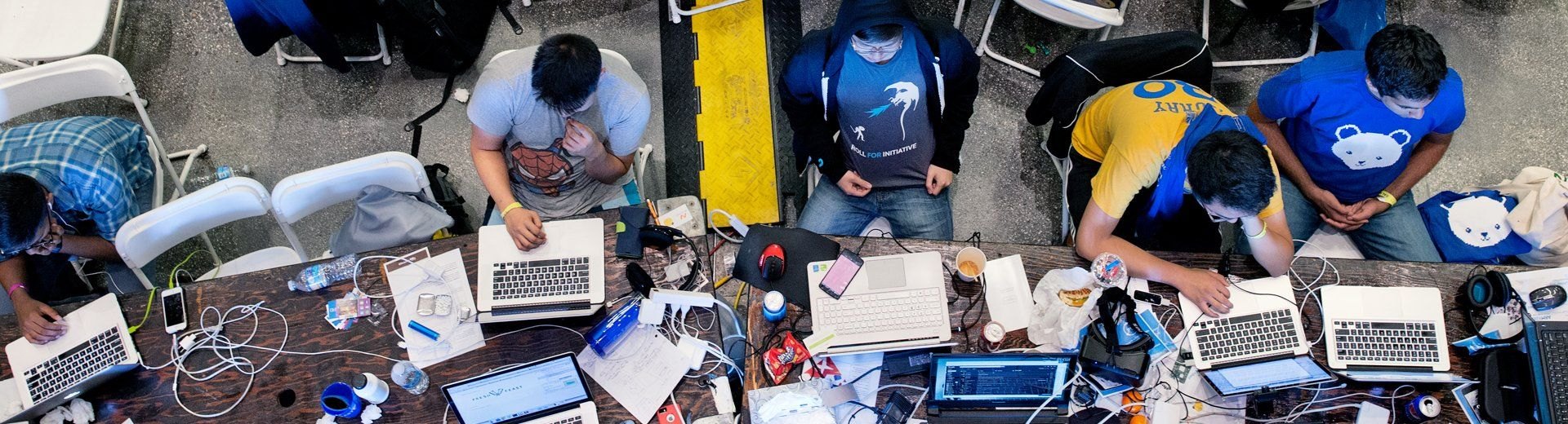 bird's-eye view of a group of people working on their laptops.